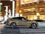 BMW X6 - BMW X6 M50i 2020 вид сбоку