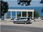 Opel Zafira - Opel Zafira Tourer 2012 вид сбоку