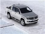 Volkswagen Amarok - внешний вид спреди: литые диски, решетка радиатора создают неповторимый стиль.
