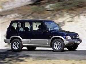 Универсальные. Неприхотливые. Доступные. (Mitsubishi Pajero Sport, Nissan Terrano II, Suzuki Grand Vitara XL-7) Grand Vitara - Suzuki Vitara 5d первого поколения вид спереди справа в динамике