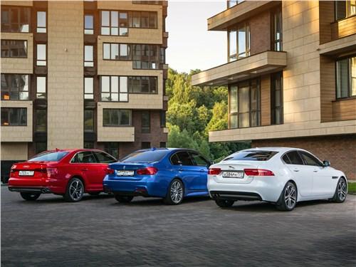 Audi A4 2016, BMW 3 2016, Jaguar XE 2016 вид сзади