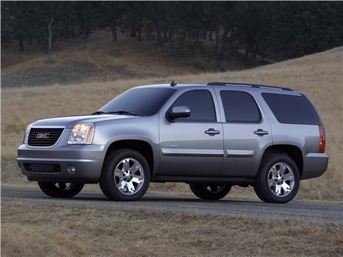 Сухопутные дредноуты (Chevrolet Tahoe, GMC Yukon, Cadillac Escalade, Ford Expedition, Lincoln Navigator) Yukon - GMC Yukon (2007) вид спереди сбоку