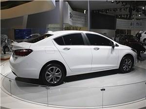 Chevrolet Cruze - Chevrolet Cruze 2015 вид сбоку сзади