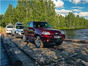 Разбитые дорожки в глухих лесах вывели нас наконец к живописной реке Сяпся