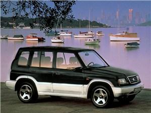 По асфальту и не только (Land Rover Freelander, Nissan X-Trail, Suzuki Grand Vitara) Grand Vitara - Suzuki Vitara 5d первого поколения вид спереди справа фото 2