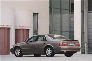 Большая тройка (Cadillac Seville, Chrysler 300M, Lincoln Continental) Seville - Cadillac Seville 1998 вид сзади слева