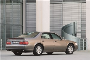Большая тройка (Cadillac Seville, Chrysler 300M, Lincoln Continental) Seville - Cadillac Seville 1998 вид сзади справа