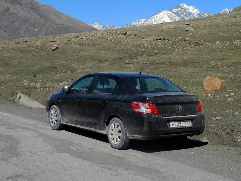 Peugeot 301 2013 вид сзади