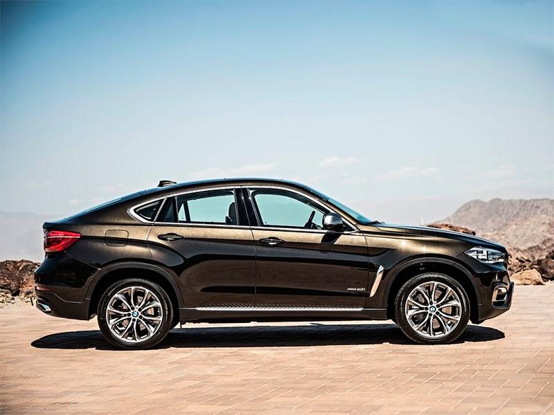 BMW X6 2015 вид сбоку