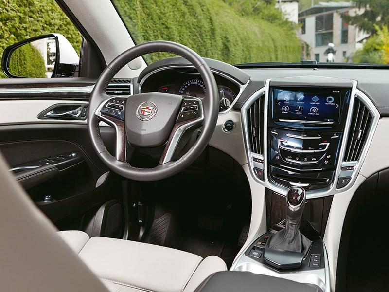 Cadillac SRX 2013 водительское место