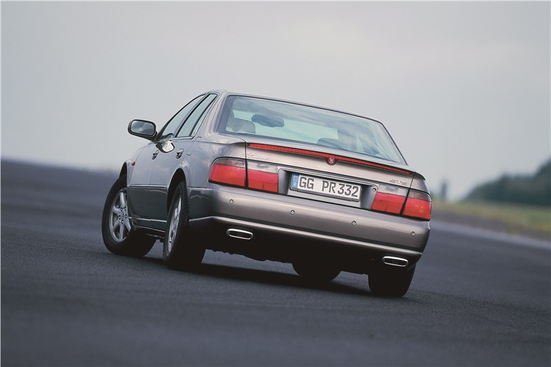 Cadillac Seville 1998 вид сзади в повороте фото 2